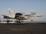 A US Navy F/A-18C Hornet Prepares to Land Aboard USS Eisenhower Photographic Print by  Stocktrek Images