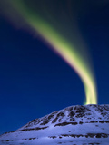 An Aurora Borealis Shooting Up from Toviktinden Mountain, Norway Photographic Print by  Stocktrek Images