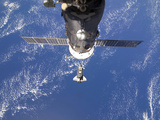 Space Shuttle Discovery Approaches the International Space Station Photographic Print by  Stocktrek Images