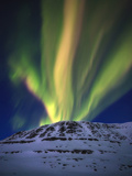 Aurora Borealis over Toviktinden Mountain in Troms County, Norway Photographic Print by  Stocktrek Images