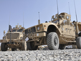 An M-ATV Mine Resistant Ambush Protected Vehicle Parked Next to a MaxxPro MRAP Photographic Print by  Stocktrek Images