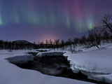 Aurora Borealis over Blafjellelva River in Troms County, Norway Photographic Print by  Stocktrek Images