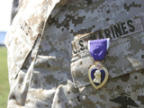 The Purple Heart Award Hangs over the Heart of a U.S. Marine Photographic Print by  Stocktrek Images