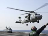 An HH-60H Sea Hawk Helicopter Takes Off from USS Ronald Reagan Photographic Print by  Stocktrek Images