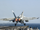 A F/A-18F Super Hornet Launches from the Flight Deck of Aircraft Carrier USS Nimitz Photographie par  Stocktrek Images