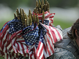 An Army Soldier's Backpack Overflows with Small American Flags Photographic Print by  Stocktrek Images