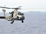 An MH-60R Seahawk Helicopter in Flight over the Pacific Ocean Photographic Print by  Stocktrek Images