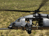 An HH-60 Pave Hawk Flies over the Desert During Angel Thunder 2010 Photographic Print by  Stocktrek Images
