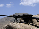 A Barrett .50-Caliber M107 Sniper Rifle Sits Atop an Observation Point in Afghanistan Photographic Print by  Stocktrek Images