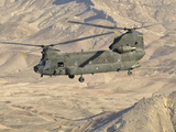 Italian Army CH-47C Chinook Helicopter in Flight over Afghanistan Photographic Print by  Stocktrek Images
