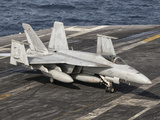 An Aircraft Director Guides an F/A-18F Super Hornet Aboard Aircraft Carrier USS Nimitz Photographic Print by  Stocktrek Images