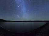 A Panoramic View of the Milky Way and La Azul Lagoon in Somuncura, Argentina Photographic Print by  Stocktrek Images