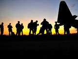 Green Berets Prepare to Board a KC-130 Aircraft Photographic Print by  Stocktrek Images
