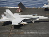 An F/A-18C Hornet Sits Ready on the Flight Deck of USS Harry S. Truman Photographic Print by  Stocktrek Images