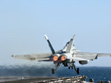 An F/A-18F Super Hornet Launches from the Flight Deck of Aircraft Carrier USS Nimitz Photographie par  Stocktrek Images