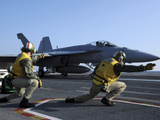 Shooters Aboard the USS George H.W. Bush Give the Go-Ahead Signal to Launch an F/A-18 Super Hornet Photographic Print by  Stocktrek Images