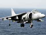 An AV-8B Harrier Hovers over the Flight Deck of USS Peleliu Photographic Print by  Stocktrek Images