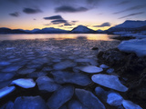 Ice Flakes Drifting Against the Sunset in Tjeldsundet Strait, Troms County, Norway Photographic Print by  Stocktrek Images