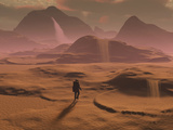 The Lone Figure of an Explorer Watching the Sandfalls of a Barren Planet Photographic Print by  Stocktrek Images