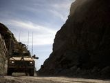 A MRAP Vehicle Drives Through the Mountains of Afghanistan Photographic Print by  Stocktrek Images