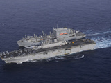 USS Kearsarge Pulls Alongside USNS Lewis and Clark for a Replenishment at Sea Photographic Print by  Stocktrek Images