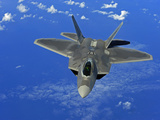 A U.S. Air Force F-22 Raptor in Flight Near Guam Photographic Print by  Stocktrek Images