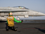 An F/A-18C Is Ready to Launch from the Flight Deck of USS Eisenhower Photographic Print by  Stocktrek Images