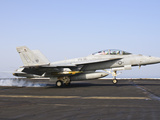 An F/A-18E Super Hornet Lands Aboard USS Harry S. Truman Photographic Print by  Stocktrek Images