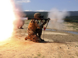 An Assaultman Fires a Rocket Propelled Grenade Photographic Print by  Stocktrek Images