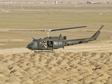 Italian Army AB-205MEP Utility Helicopter in Flight over Shindand, Afghanistan Photographic Print by  Stocktrek Images