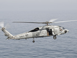 An SH-60F Seahawk Gets Airborne from the Deck of USS Harry S. Truman Photographic Print by  Stocktrek Images