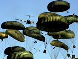 A U.S. Air Force C-17 Globemaster III Airdrops Pallets to Port-Au-Prince, Haiti Photographic Print by  Stocktrek Images