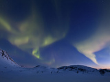 Aurora Borealis over Skittendalen Valley in Troms County, Norway Photographic Print by  Stocktrek Images
