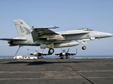 A US Navy F/A-18E Super Hornet Prepares to Land Aboard USS Eisenhower Photographic Print by  Stocktrek Images