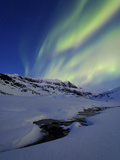 Aurora over Skittendalstinden in Troms County, Norway Photographic Print by  Stocktrek Images