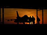 Silhouette of a Chilean Air Force F-16C Block 50 at Natal Air Force Base, Brazil Photographic Print by  Stocktrek Images
