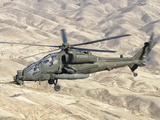 An Italian Army AW-129 Mangusta over Afghanistan Photographic Print by  Stocktrek Images