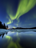 Aurora Borealis over Sandvannet Lake in Troms County, Norway Fotoprint van Stocktrek Images