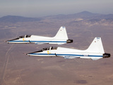 Two T-38A Mission Support Aircraft Fly in Tight Formation Photographic Print by  Stocktrek Images