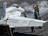 Flight Deck Crew Position an F/A-18E Super Hornet into Launch Position Aboard USS Eisenhower Photographic Print by  Stocktrek Images