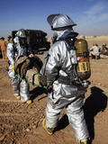 Firefighters Move a Casualty to a Triage Area at Camp Dwyer, Afghanistan Photographic Print by  Stocktrek Images