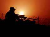 A U.S. Special Forces Soldier Armed with a Mk-12 Sniper Rifle at Sunset Fotoprint van Stocktrek Images