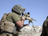 A U.S. Marine Looks Through the Scope of an M40A1 Sniper Rifle Photographic Print by  Stocktrek Images