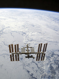 The International Space Station in Orbit Above Earth Photographic Print by  Stocktrek Images