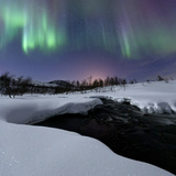 Aurora Borealis over Blafjellelva River in Troms County Photographic Print by  Stocktrek Images