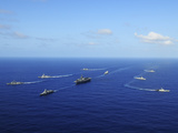 Ships from the Ronald Reagan Carrier Strike Group Transit the Pacific Ocean Photographic Print by  Stocktrek Images