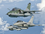 A Brazilian Air Force Embraer A-1B, French Air Force Rafale, and US Air Force F-16C Fighting Falcon Photographic Print by  Stocktrek Images
