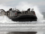 U.S. Navy Landing Craft Air Cushion Makes a Beach Landing Photographic Print by  Stocktrek Images
