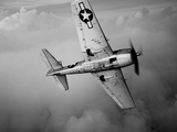 A Grumman F6F Hellcat Fighter Plane in Flight Photographie par  Stocktrek Images