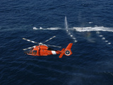 A Helicopter Crew Trains Off the Coast of Jacksonville, Florida Photographic Print by  Stocktrek Images